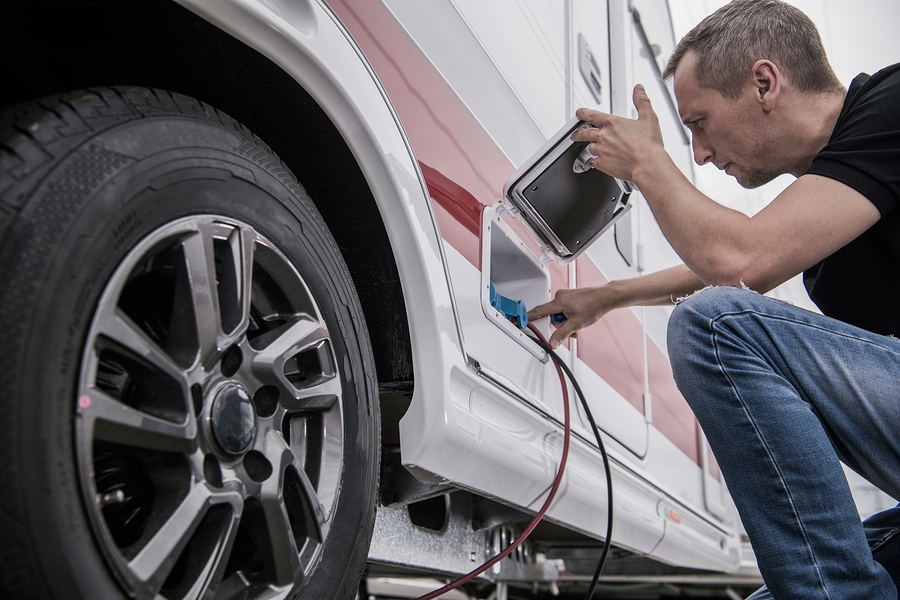 Caucasian Technician Trying To Fix RV Travel Trailer Electric
